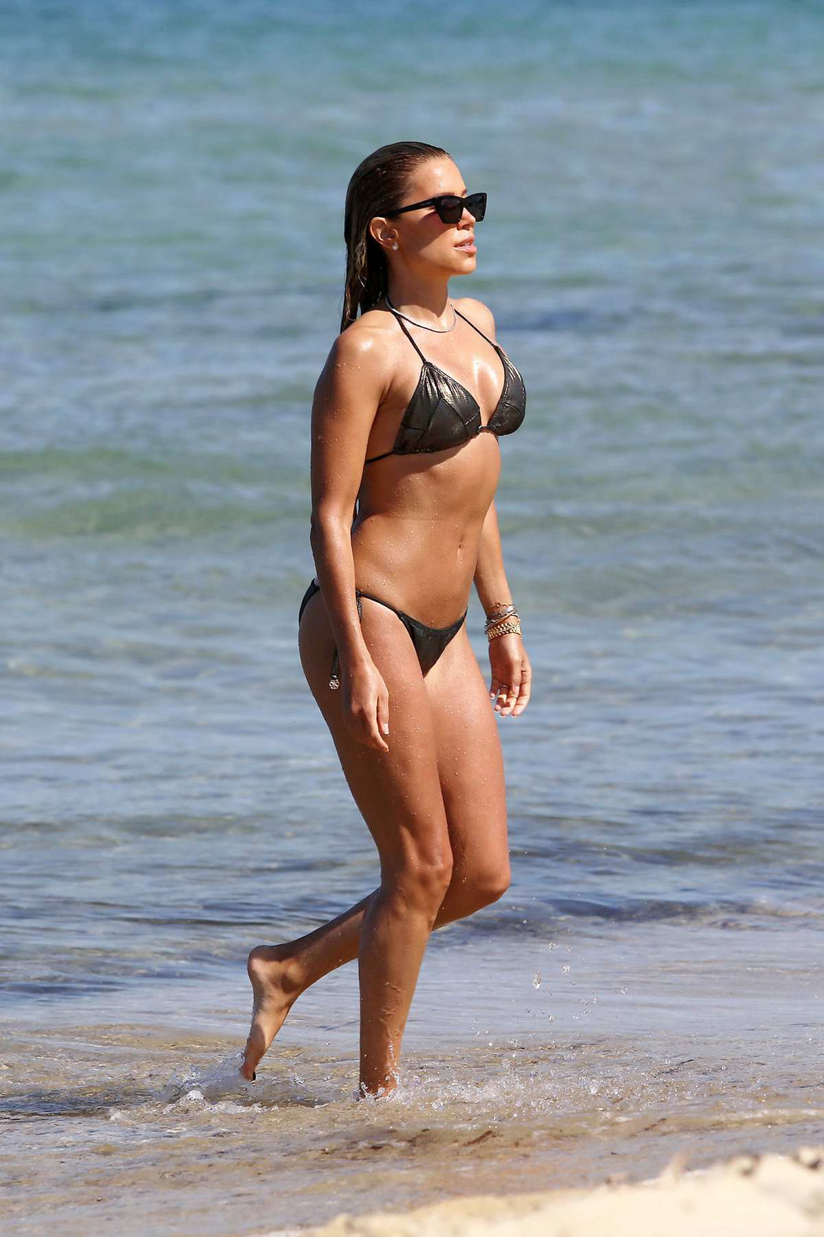 Sylvie Meis shows off her beach body in a bikini as she enjoys a day with Niclas Castello in Saint Tropez, France