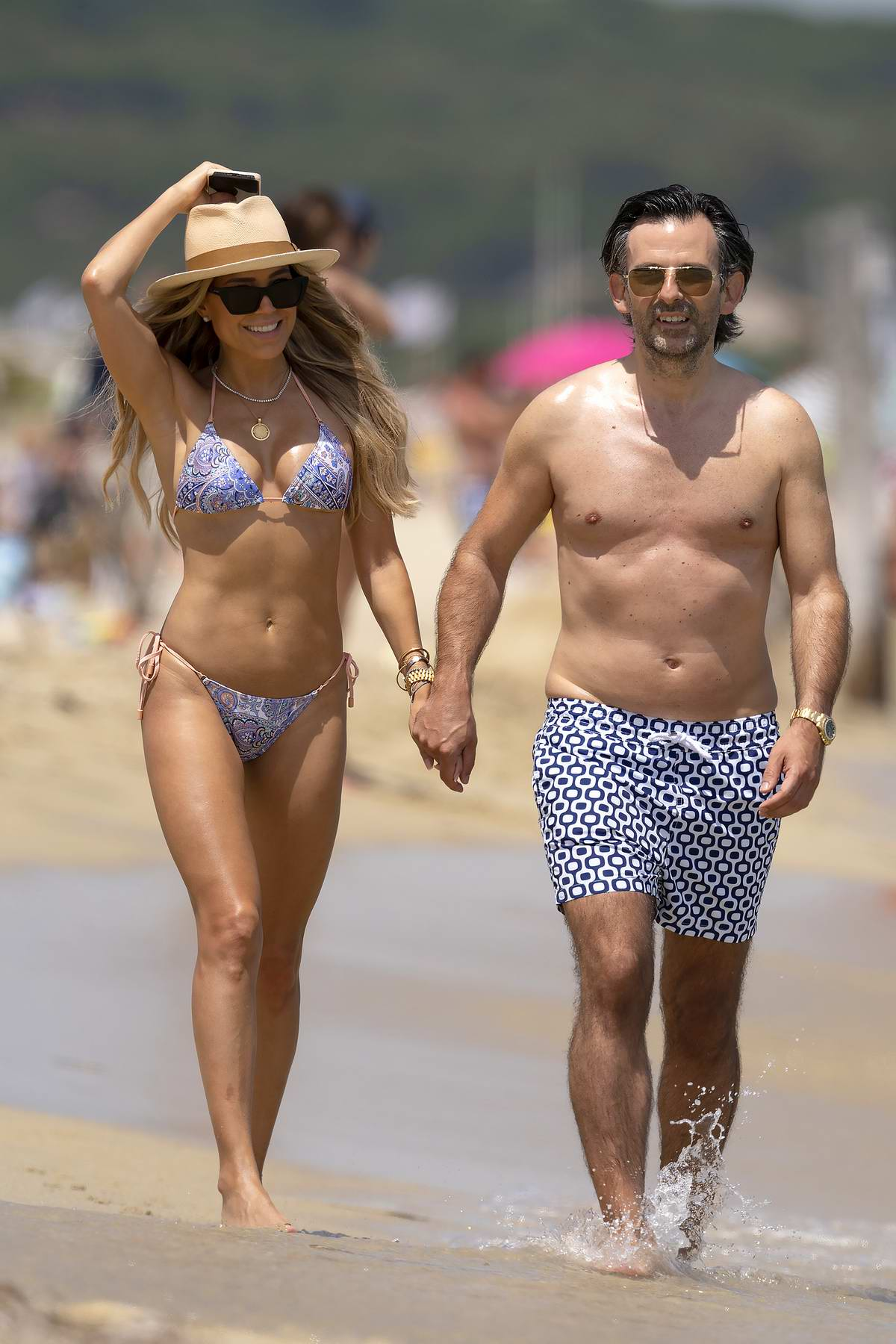Sylvie Meis wears a patterned blue bikini while enjoying a beach day with fiance Niclas Castello in Saint Tropez, France