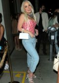 Tana Mongeau is all smiles as she arrives for dinner with friends at Catch in West Hollywood, California