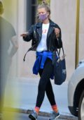 Toni Garrn and Alex Pettyfer spotted with large suitcases in New York City