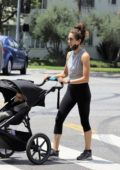 Troian Bellisario steps out for a walk with her baby in Los Angeles
