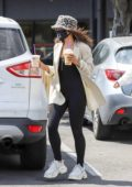 Vanessa Hudgens covers her face with a mask during a coffee run with a friend in Los Angeles