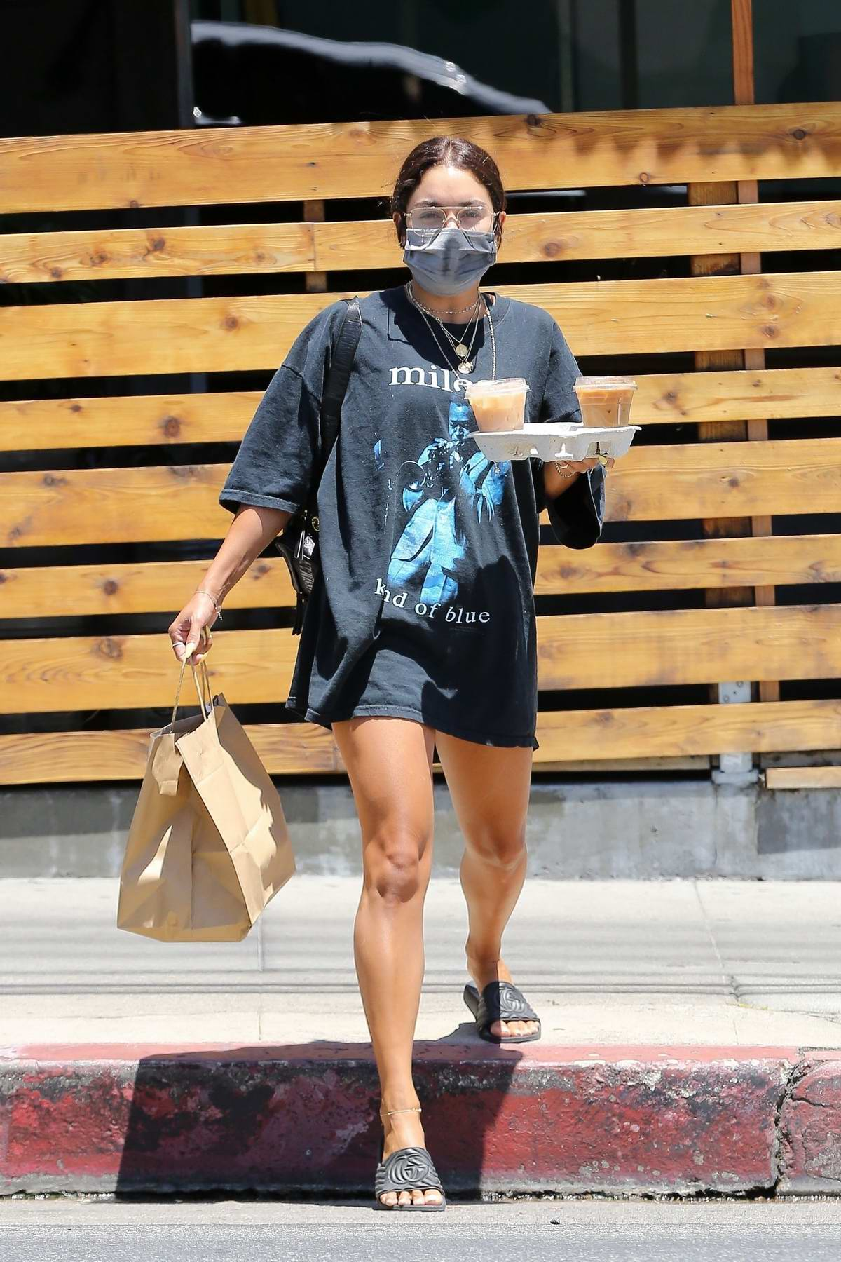 Vanessa Hudgens dons an oversized t-shirt and shorts as she grabs some food and coffee in Los Angeles
