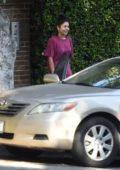Vanessa Hudgens looks animated as she and her mom appear to donate a bunch of stuff to a friend in Los Angeles