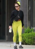 Vanessa Hudgens shows off her toned legs in green leggings while making a post-workout juice run at Earthbar in West Hollywood, California