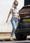 Vanessa Kirby shows off her toned midriff in a crop top while out for some shopping at a local market in London, UK