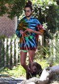 Alessandra Ambrosio dons a colorful tie-dye sweater while walking her dogs with her son in Brentwood, California