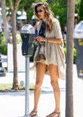 Alessandra Ambrosio looks stunning as she feeds the parking meter while out to lunch in Pacific Palisades, California