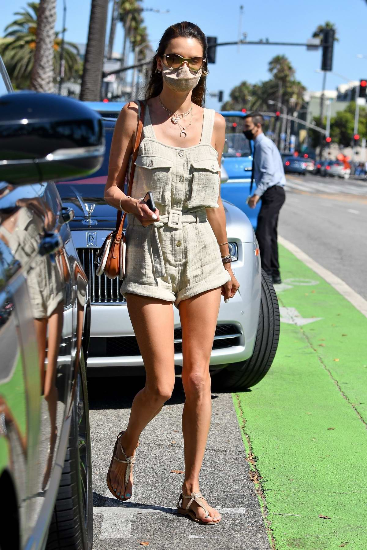 Alessandra Ambrosio looks trendy in a grey romper during a lunch outing with a friend in Santa Monica, California