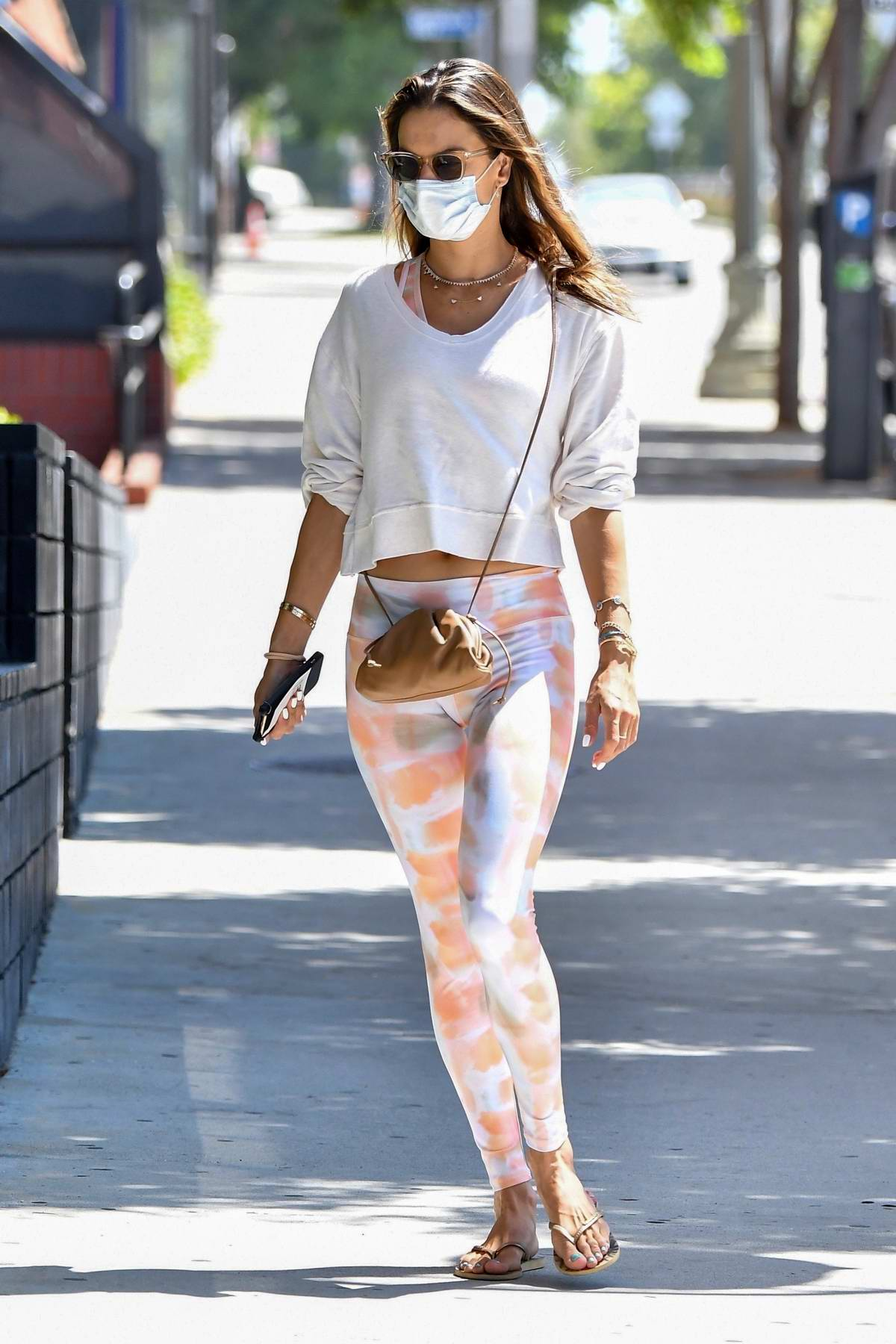 Alessandra Ambrosio sports a white sweatshirt and leggings as she hits the gym in Santa Monica, California