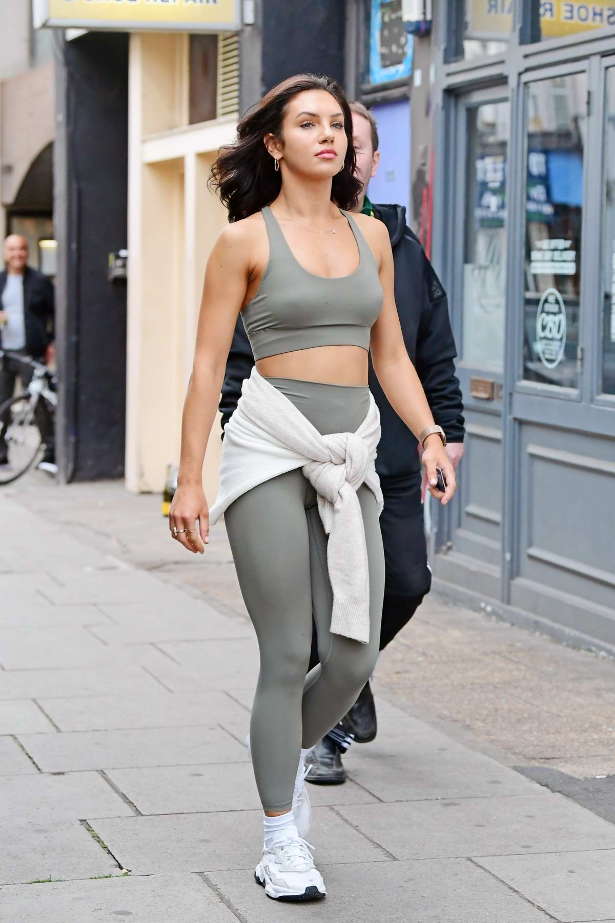 Alexandra Cane looks great in a green crop top and leggings while out with friends in Notting Hill, California
