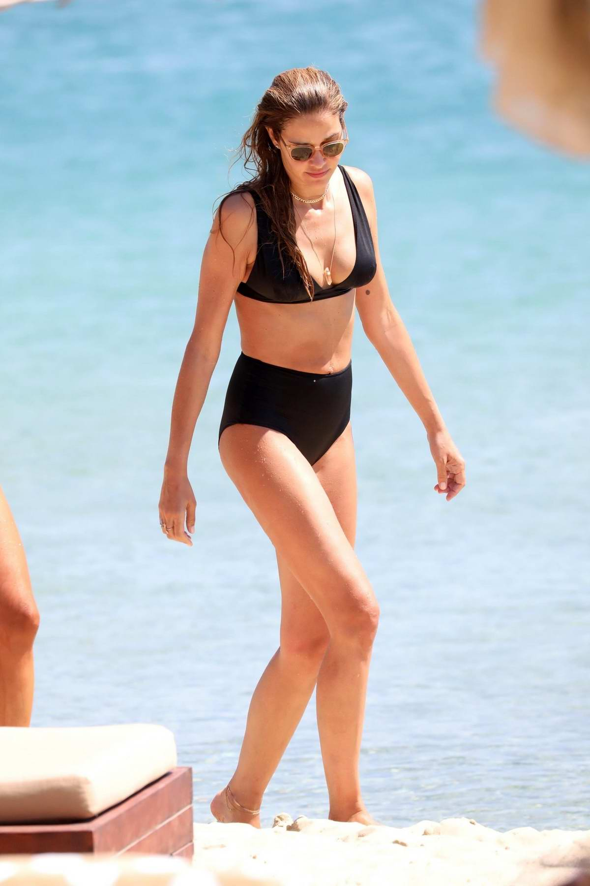 Ana Beatriz Barros dons a black bikini as she spends a day on the beach while on holiday in Mykonos, Greece