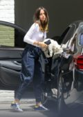 Ana de Armas seen wearing a white top and baggy denim arrives at Ben Affleck's home in Brentwood, California