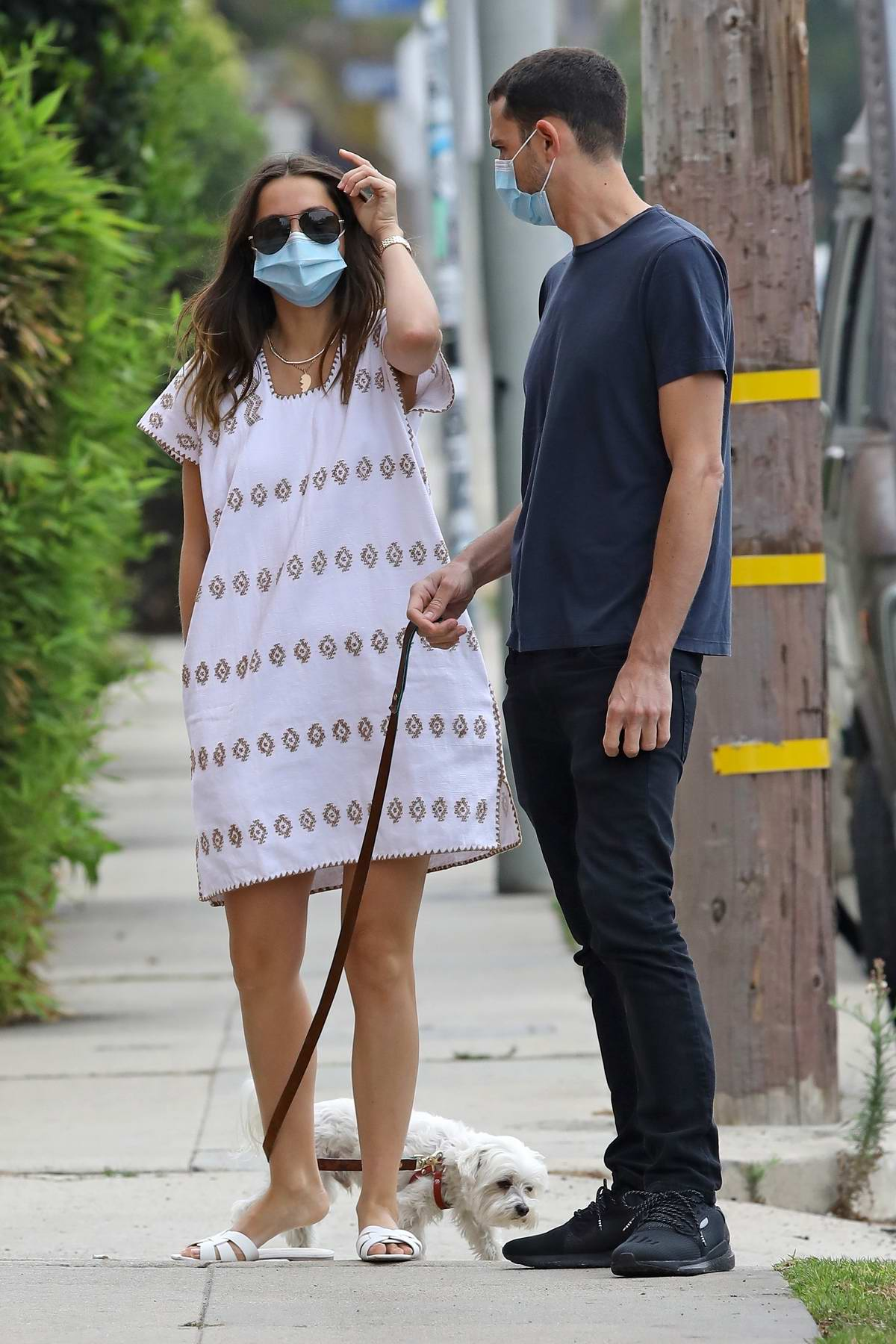 Ana de Armas wears a white dress while out for a morning walk with her brother in Venice, California