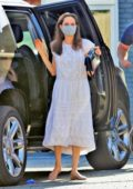 Angelina Jolie looks chic in a white dress as she steps out with her daughter for some shopping in Los Feliz, California