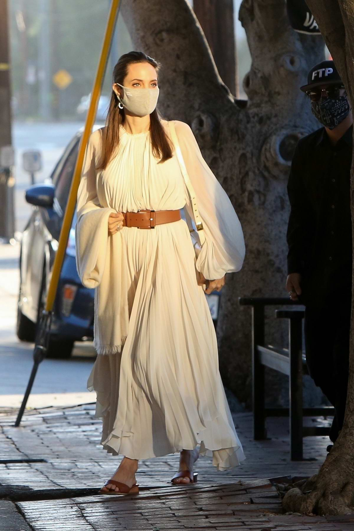Angelina Jolie looks chic in a white dress while out for dinner with son Pax at AOC restaurant in West Hollywood, California