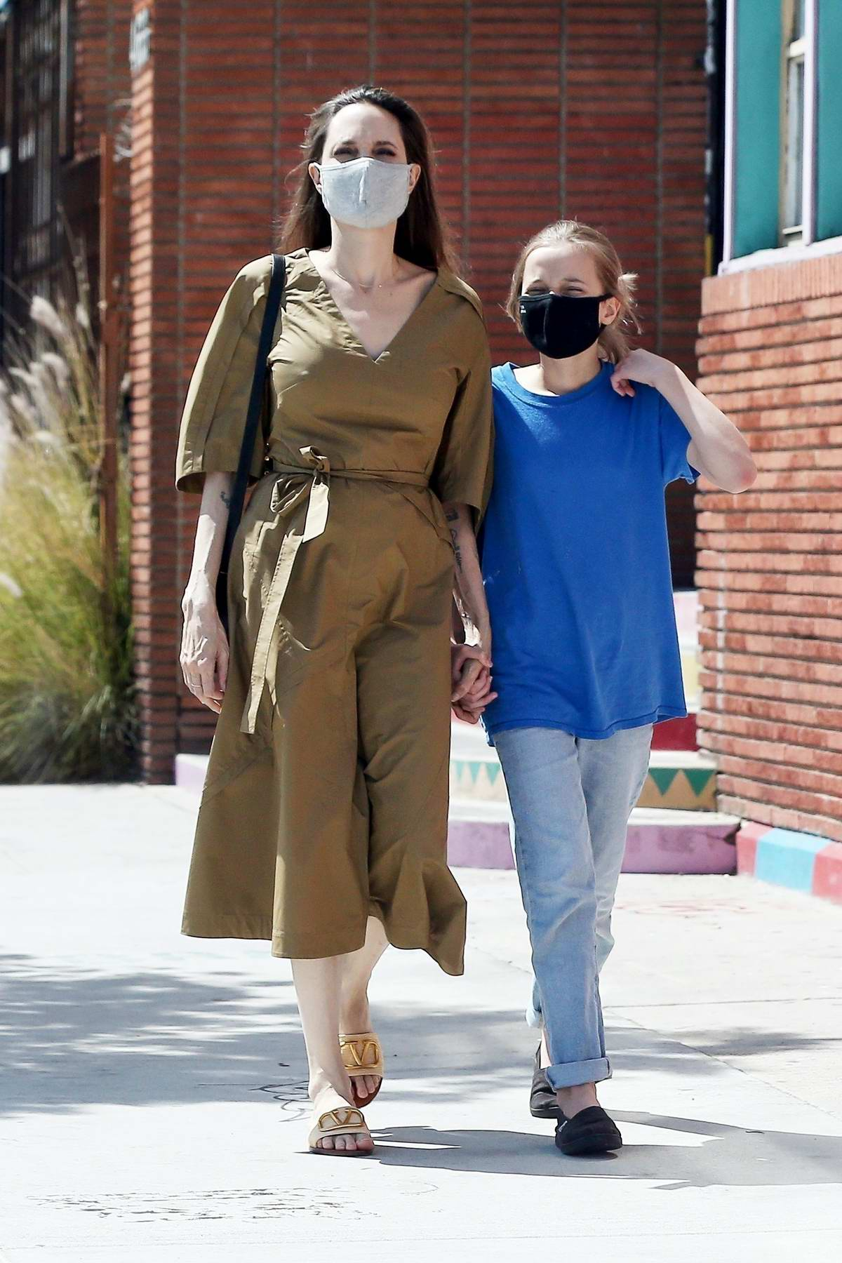Angelina Jolie stops at Soap Plant Wacko while out shopping with her daughter Vivienne in Los Angeles