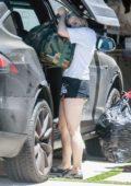 Ariel Winter helps her boyfriend Luke Benward move in to her home in Los Angeles