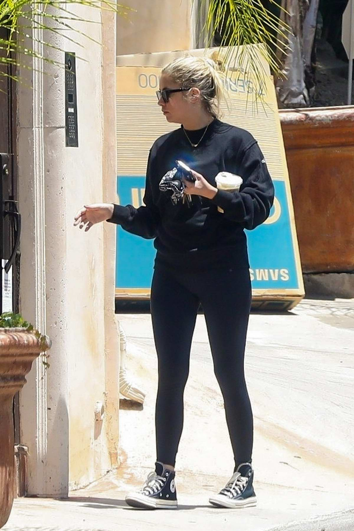 Ashley Benson arrives back at boyfriend G-Eazy's home after an iced coffee run in Los Angeles
