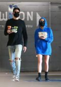 Ashley Benson goes incognito in a hoodie as she and G-Eazy grab takeout at Erewhon Market in Los Angeles