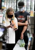 Ashley Benson shops for Casamigos Tequila and Grapefruit Juice with a friend in Los Feliz, California