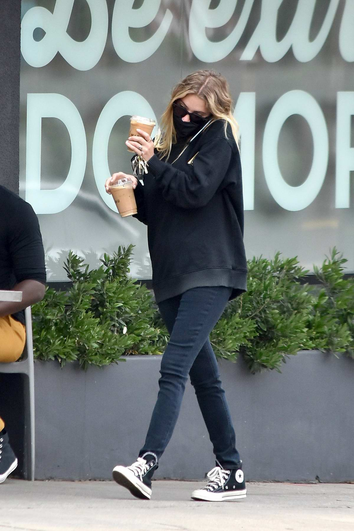 Ashley Benson sports a black sweatshirt and jeans during a coffee run in Los Angeles