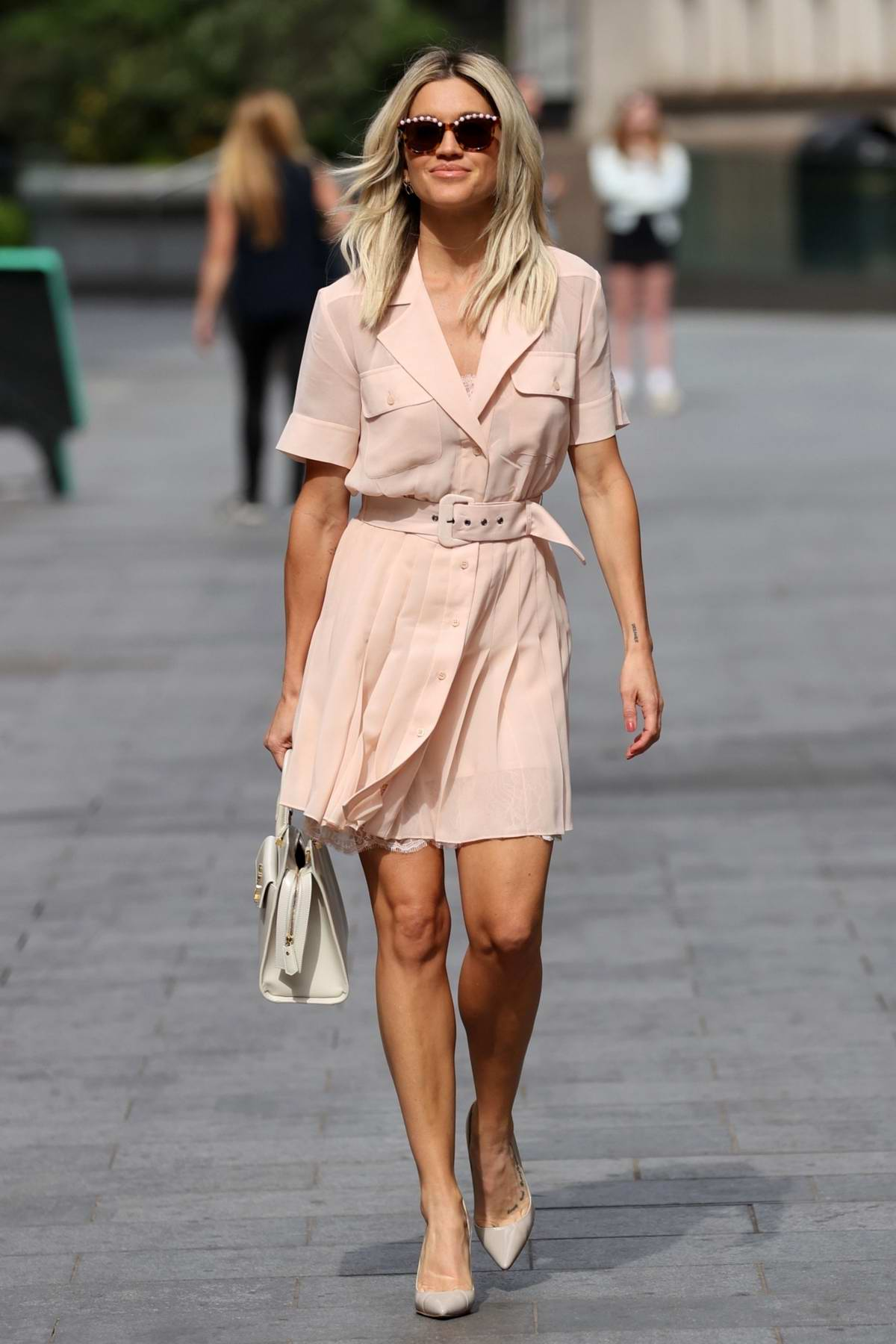 Ashley Roberts looks pretty in a pink mini dress as she exits the Heart Radio in London, UK