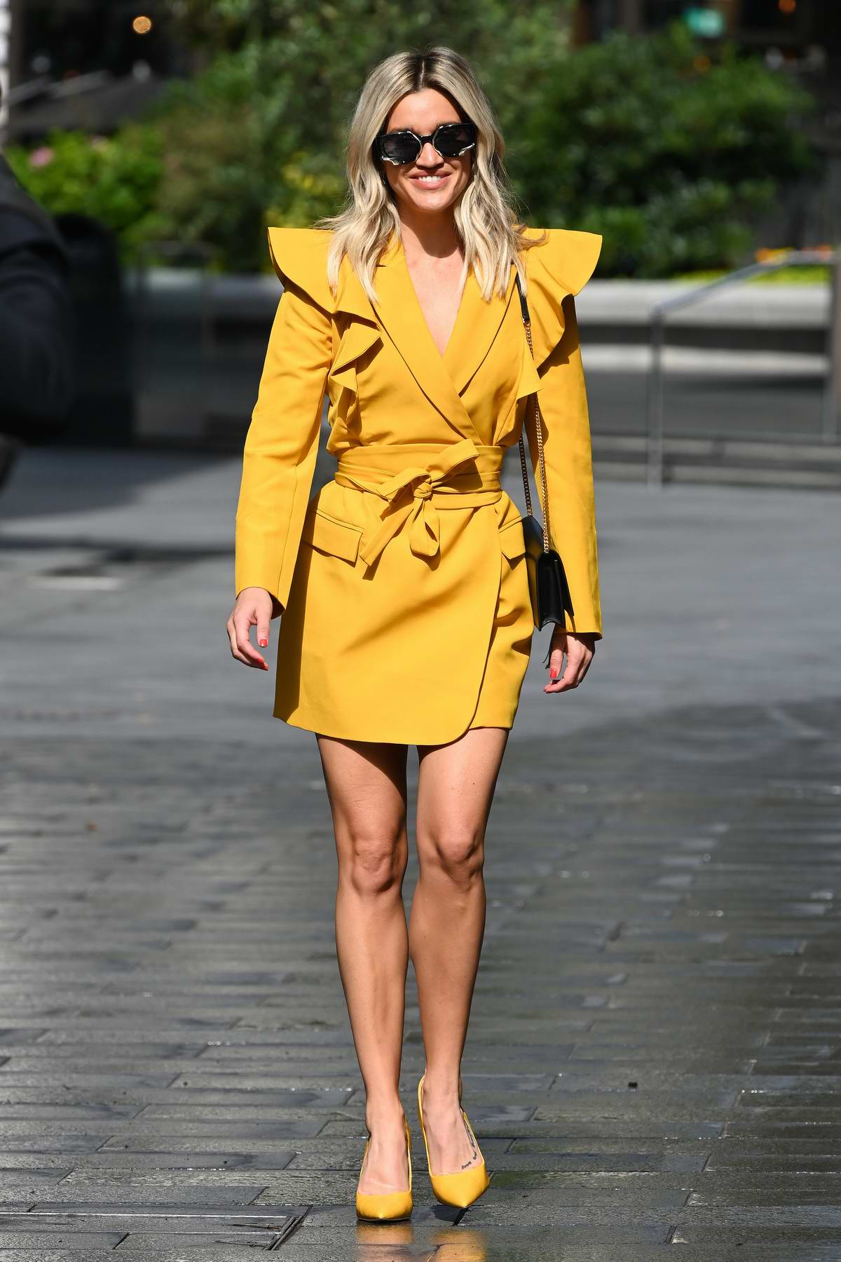 Ashley Roberts looks striking in a yellow dress and matching heels as she leaves Global Radio in London, UK