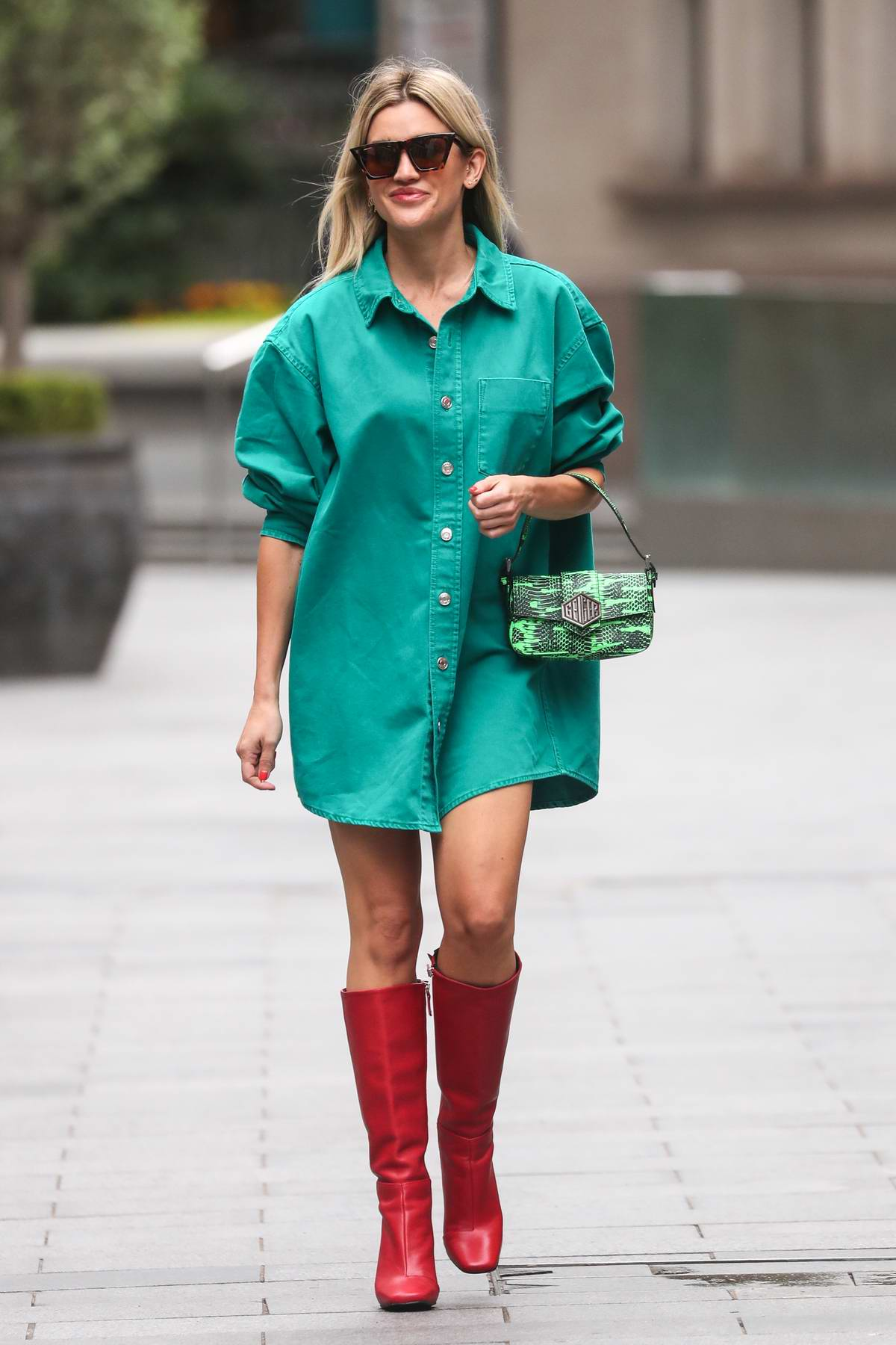 Ashley Roberts looks stylish in a teal-green shirt dress and red boots as she leaves Heart radio in London, UK
