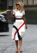 Ashley Roberts looks stylish in a white dress with red and black accent as she leaves Global Radio studios in London, UK