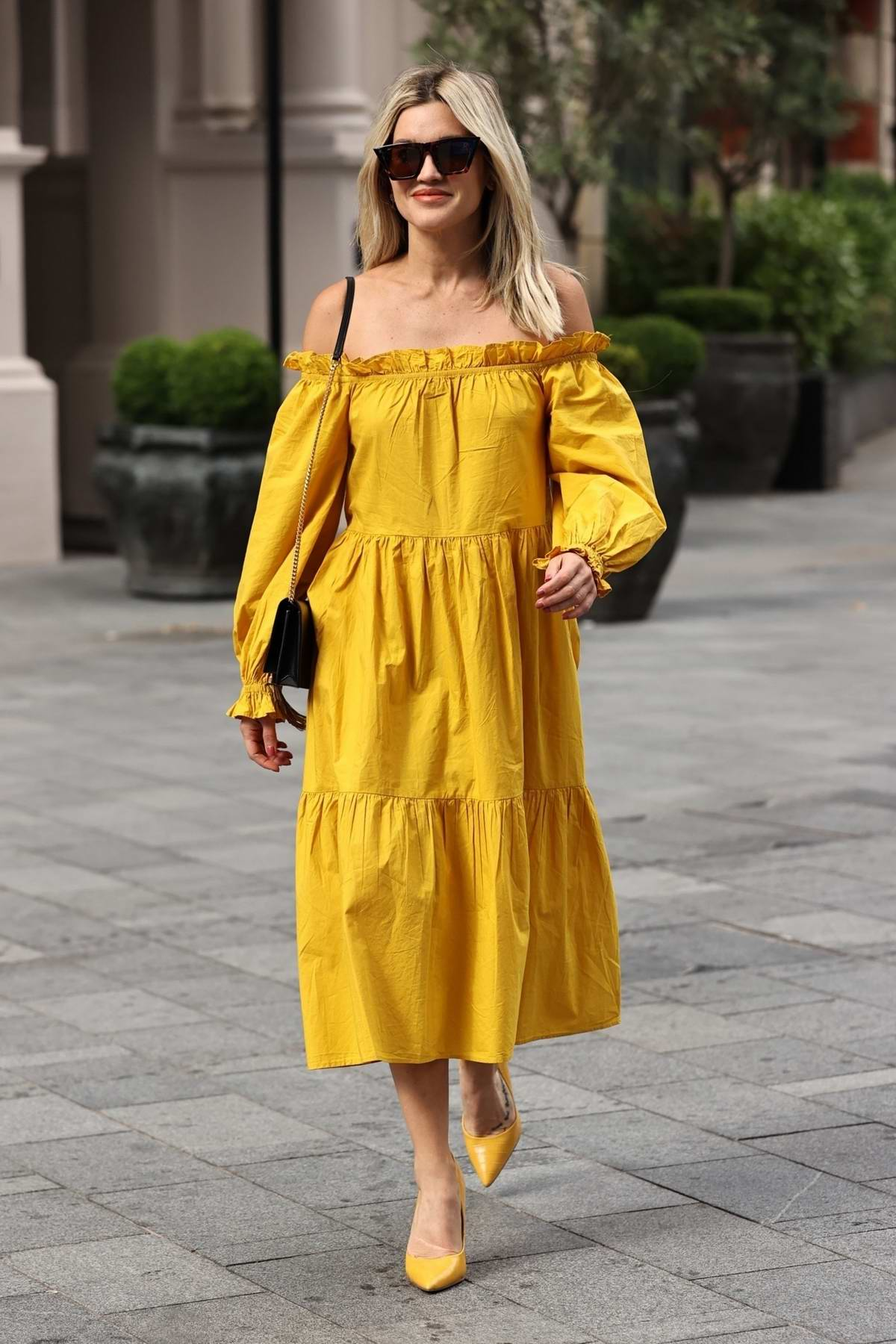 Ashley Roberts looks vibrant in mustard yellow dress as she arrives at Global Radio studios in London, UK