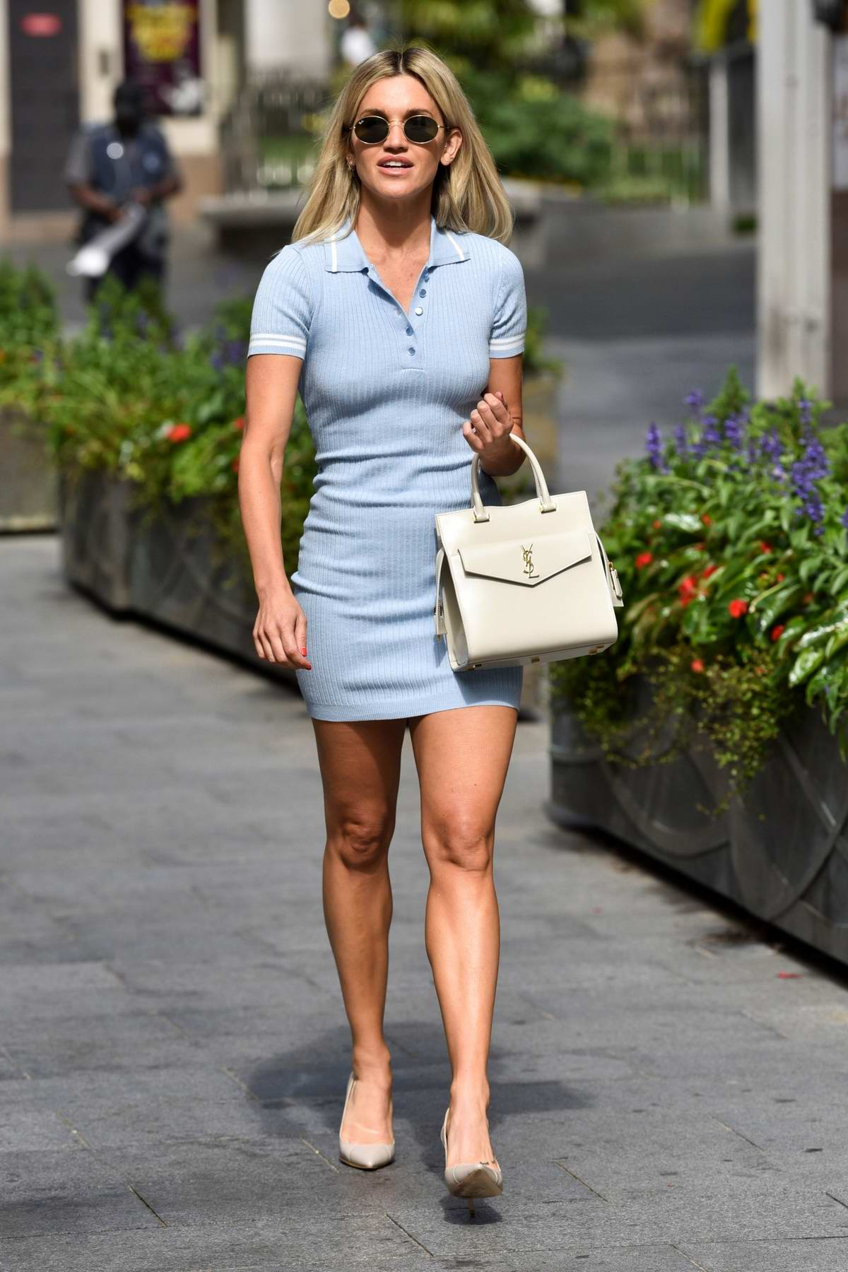 Ashley Roberts shows off her toned legs in a baby blue mini dress as she leaves Heart radio in London, UK