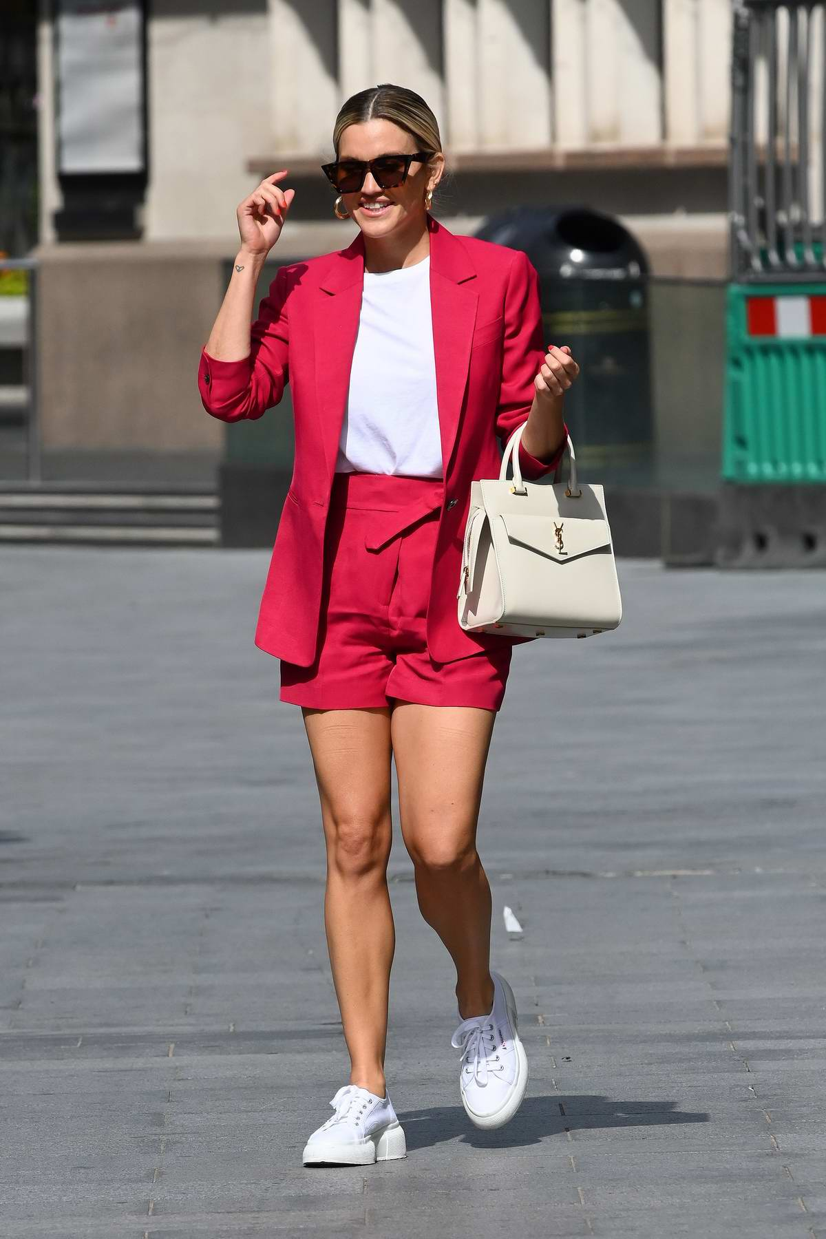Ashley Roberts steals the spotlight in hot pink shorts suit at Heart Radio in London, UK