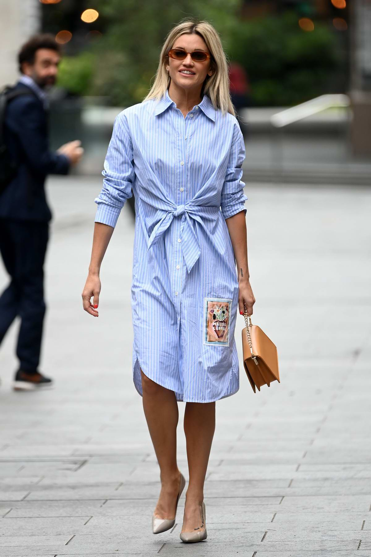 Ashley Roberts wears a blue striped shirt dress as she leaves at Global Radio studios in London, UK