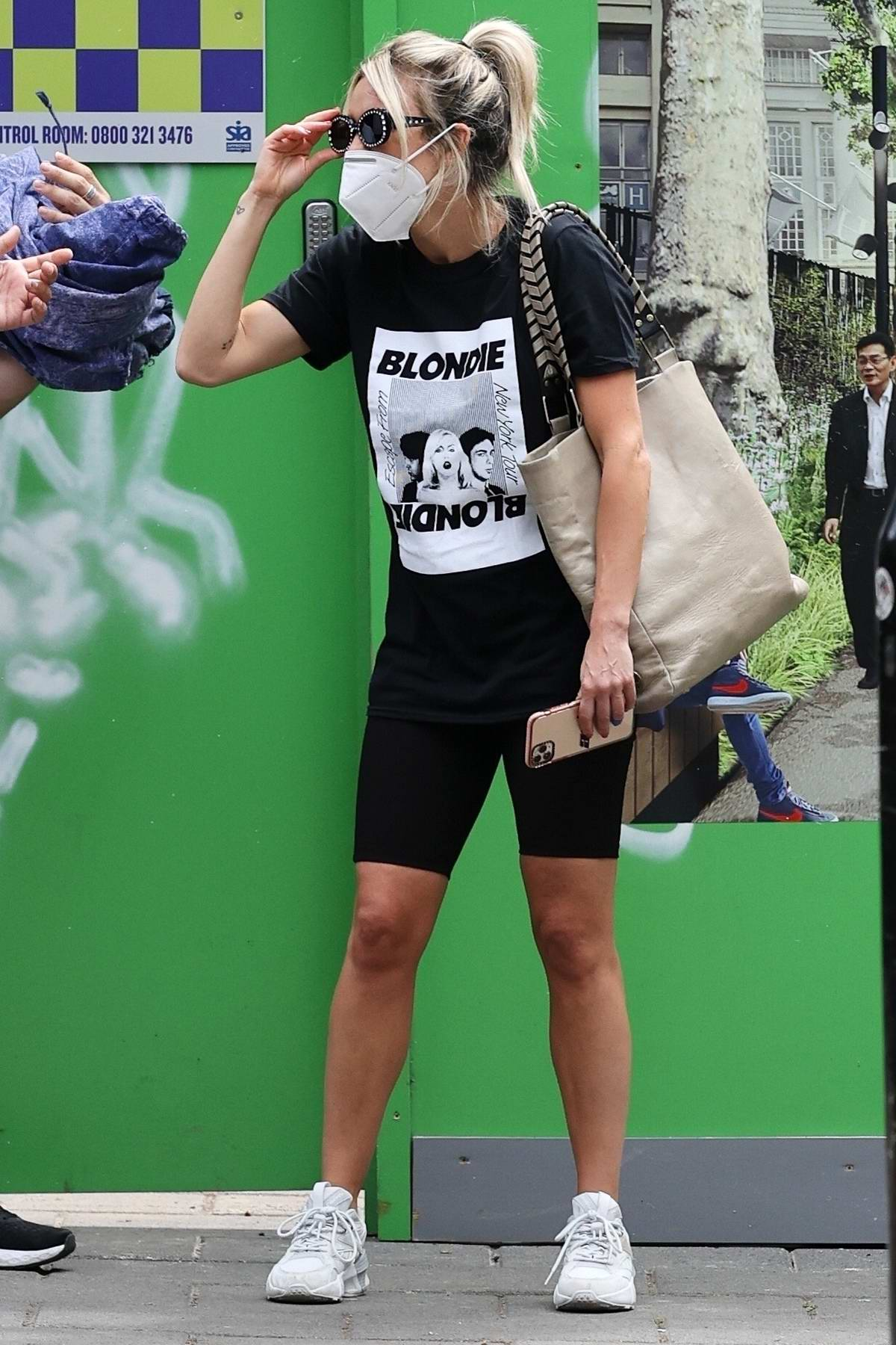 Ashley Roberts wears face mask while leaving a soup kitchen after doing voluntary work in London, UK