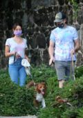 Aubrey Plaza And Jeff Baena walk their dogs matching tie-dye tees in Los Angeles