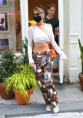 Bella Hadid displays her toned midriff in a crop top while visiting Aimé Leon Dore store in New York City