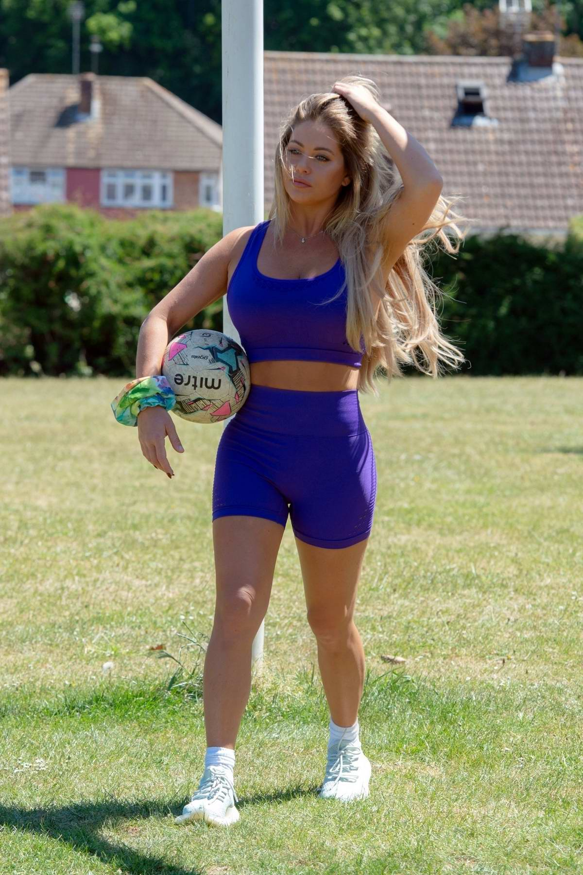 Bianca Gascoigne gets in her workout by playing some football at a local park in Kent, UK