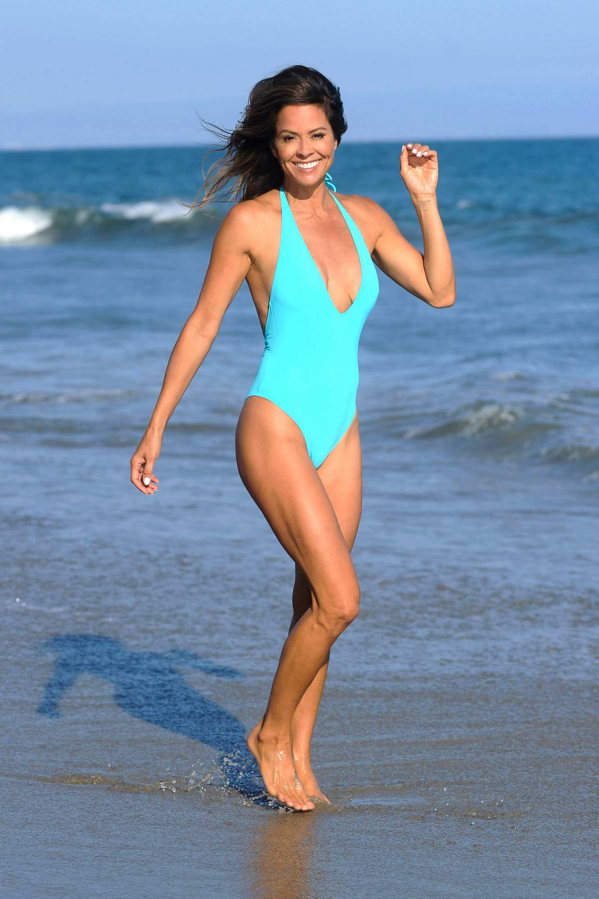 Brooke Burke enjoys the beach in an aqua blue swimsuit in Malibu, California