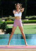 Brooke Burke poses for her Brooke Burke Body app in the backyard of her house in Malibu, California