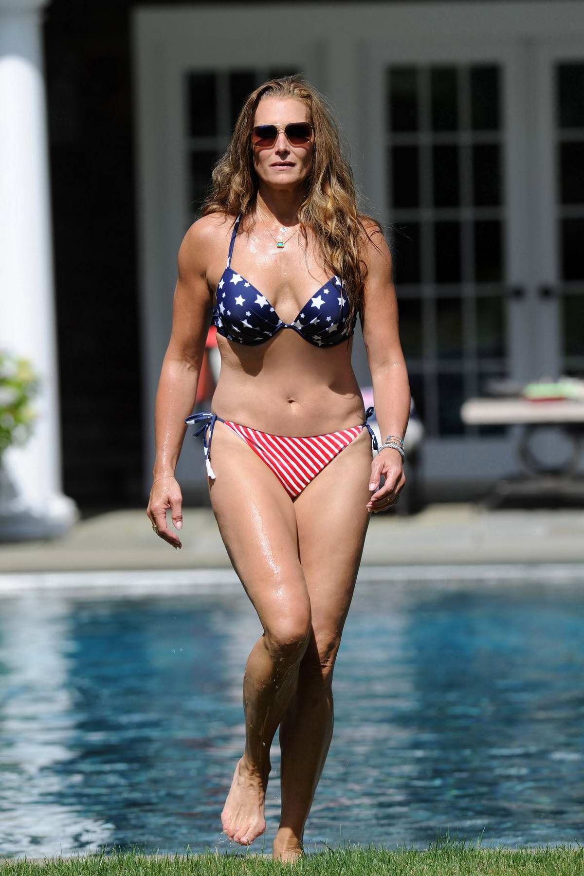 Brooke Shields stuns in a bikini as she takes a dip at her home pool in The Hamptons, New York