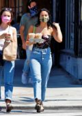 Camila Mendes makes a stop for some iced coffee at a local Starbucks with a girlfriend in Los Angeles