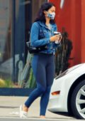 Camila Mendes shows off her toned legs in navy leggings while making a coffee run in her Tesla in Los Angeles
