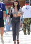 Camila Mendes wears a knotted top and jeans while out for coffee in Los Angeles