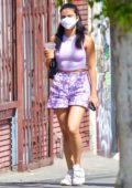 Camila Mendes wears purple tank top and shorts during a coffee run with boyfriend Grayson Vaughn in Los Feliz, California