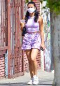 Camila Mendes wears purple tank top and shorts during a coffee run with boyfriend Grayson Vaughn in Los Feliz, California