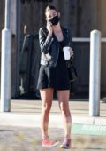 Camila Morrone looks stunning in a black mini dress and leather jacket while out on a coffee run in Malibu, California