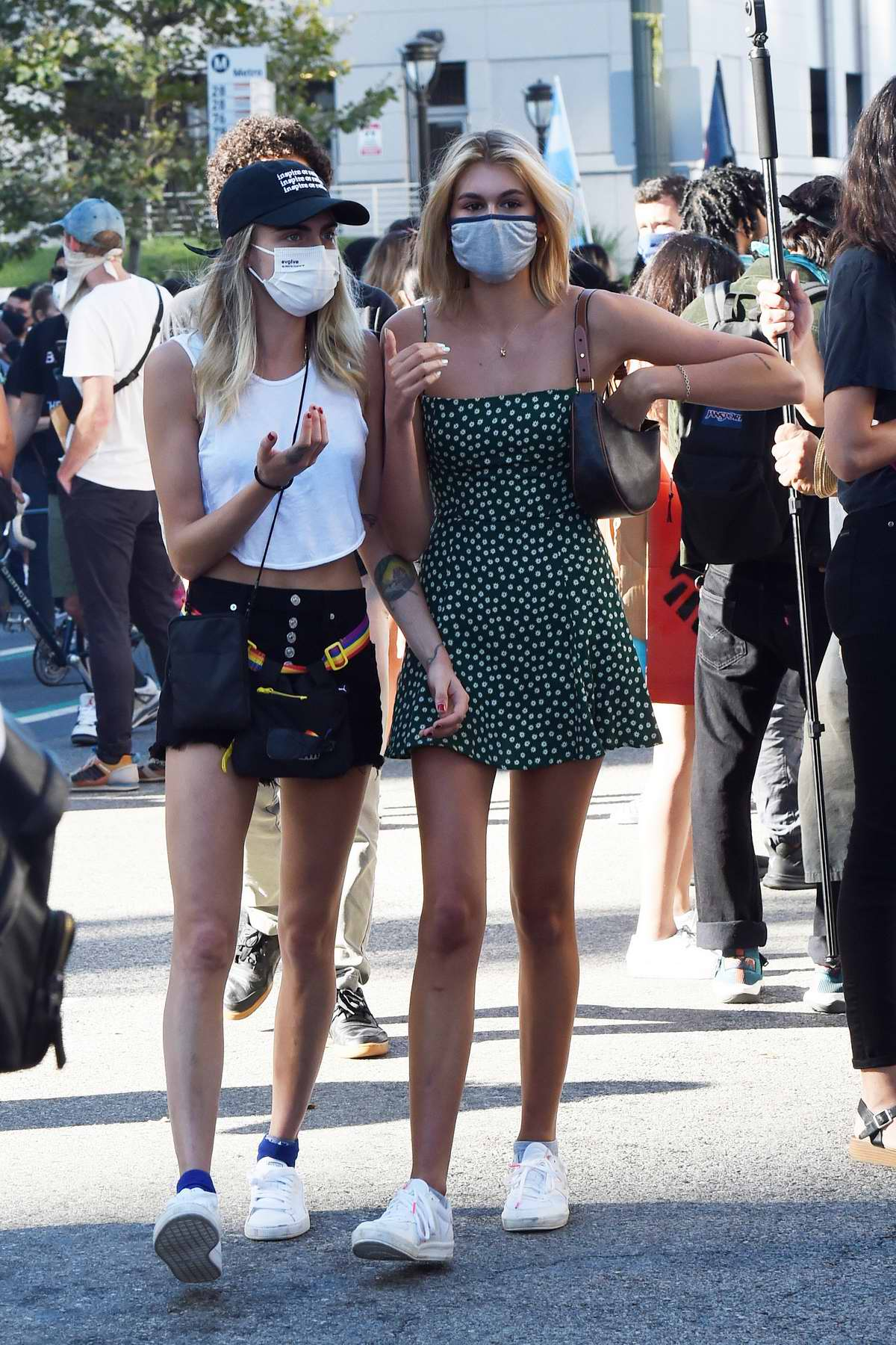 Cara Delevingne and Margaret Qualley walk hand in hand with Kaia Gerber while attending a BLM protest in Los Angeles