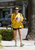 Charli XCX seen wearing a yellow jumper and black shorts as she leaves a gym in Los Angeles