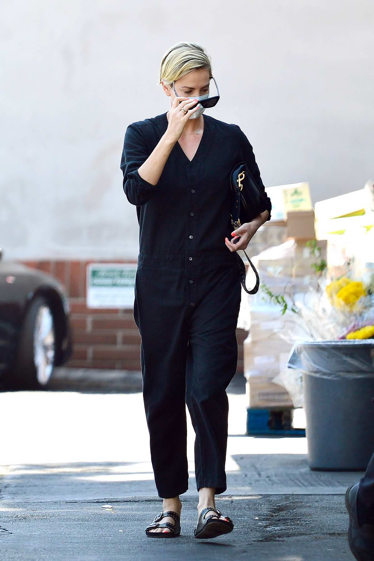 Charlize Theron stops by the market to pick up some groceries and flowers in Los Angeles